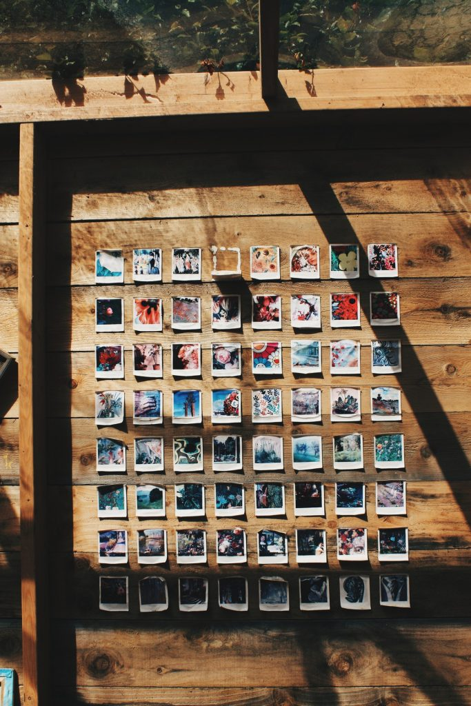 Assorted printed photos placed on a wall