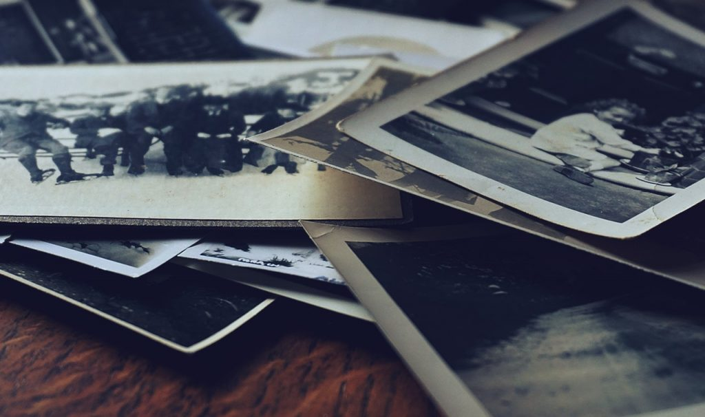 Assorted black and white photos on a table