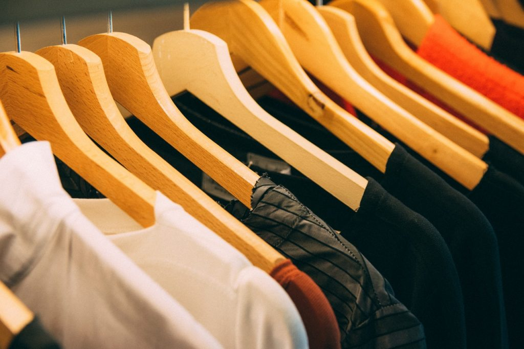 shirts placed in hangers on a rack